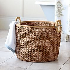 Seagrass Basket. Hand woven of sustainable seagrass with wood trim and galvanized metal accents.