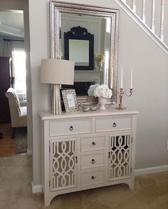 We love a good design! used ivory colors paired with mirrors and silver accents to create this beautiful featuring our Cream Mirrored Gatehill Cabinet. You can add this to your home at the link in our bio. Feature Wall Living Room, Living Room Mirrors, Front Entry Decor, Entryway Decor, Entryway Ideas, Entryway Cabinet, Cabinet Decor, Kirkland Home Decor, Dining Room Buffet