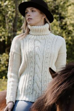 Saddle up for this beautiful sweater from Novita Natura 100 % wool yarn. Cables and lace alternate, giving just enough challenge for any knitter. Easy Sweater Knitting Patterns, Christmas Knitting Patterns, Lace Knitting, Aran Sweaters, Cardigans, Nordic Sweater, Lace Sweater, Knitting Accessories, Sweater Design