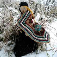 A knitted Theodora keeping warm in her Icelandic shawl.