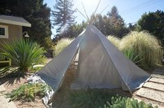 teepee DIY: bamboo poles+painters drop cloths+hole punch+some nuts & bolts+rope