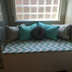DIY bathtub turned sitting area. We used wood from Lowes (have them cut to size), twin bed mattress padding, staple gun, and the fabric is one giant curtain. Found it on clearance at Bed Bath & Beyond. The pillows are from Ross. Very inexpensive way to turn an unused area into a nice decorative piece.
