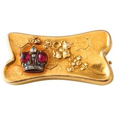 For Sale on 1stdibs - Fabergé Ruby and Diamond Presentation Brooch, ca. 1890s A rare brooch depicting a blooming cherry blossom twig on a honeycomb background and showing an
