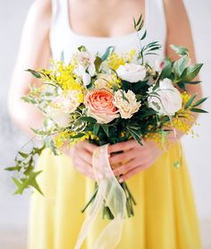 Stunning Spring Wedding Bouquets | Blush garden roses, acacia mimosa, and wiry greens give this bouquet it's springy feel, especially with a yellow bridesmaid dress or skirt.