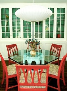I love the paint on the inside of the cabinet.  Paired with the coral chairs it' adorable