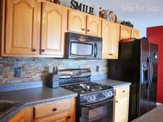 ]Slate tile backsplash (from Lowes) with golden oak cabinets, gray laminate countertop and black appliances]  .:sun stone kitchen backsplash:.