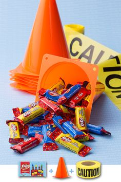 DIY Construction Goodie Bag — These party favor-packed goodie bags are perfect for a KIT KAT-errific construction-themed birthday party. The only zone your little construction crew will be marking off is the party zone! What you'll need: HERSHEY'S Birthday candy, construction cones and caution tape. Tie the caution tape through cone holes, fill, and the bag is ready to get to work! Let's make your child's party the sweetest celebration ever, with HERSHEY'S Birthday candy. Let's Birthday!