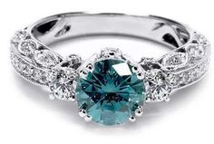 Blue diamond engagement rings are beautiful and unique. You can't help but notice a blue diamond engagement ring on a woman's finger. Pretty Rings, Beautiful Rings, Engagement Jewelry, Diamond Engagement Rings, Oval Engagement, Diamond Dreams, Do It Yourself Jewelry, Ring Verlobung, Blue Rings