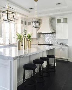 Artistic Tile I Ranked in Houzz.com's Top 10 Kitchens in 2016, this breathtaking Airmont, NY kitchen was designed by Signature Interior Designs NY. Our Dapper Daisy mosaic in White/Silver illuminates the backsplash with a floral arrangement of Jazz Glass and mirror tile.