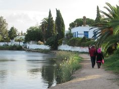 A couple strolls along the bank of the ancient Punic port of Carthage near Tunis, Tunisia. Carthage, Couple, Cartago, Couples
