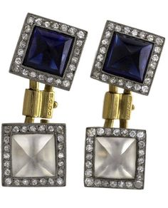 A pair of French Art Deco platinum, 18 karat gold, diamond and sapphire cuff links. The cuff links have pyramid cabochon sapphires and pyramid cabochon rock crystal that are surrounded by a square of old European-cut milligrain set diamonds. Circa 1920's.