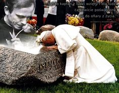 Pope John Paul II kneeing at the grave site of a young martyr Priest from Poland