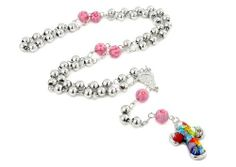 Millefiori 6mm Rosary 26'' Necklace With Murano Glass Multi Color Cross Pendant And Pink Ball Accent Millefiori. $186.00. Authentic Murano Glass from Italy. Designer Jewelry by Alan K.. Approximate cross Length: 22 MM (0.86 INCHES). Approximate cross Width: 20 MM (0.78 INCHES). Handmade (patterns and colors may slightly vary). Save 52%!