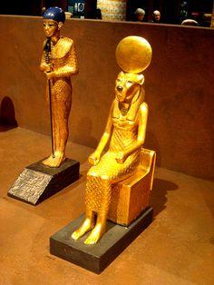 God Ptah and goddess Sekhmet   Sekhmet is the lion-headed sitting figureine. From Tutankhamun's Tomb. Flickr - Photo Sharing!