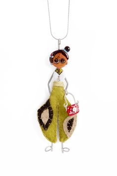 Name - TILLI,  Role – coach,  Quality – a huge sense of humor,  Hobby – shopping,  accessory – purse.  Materials – sterling silver, glass and felt.