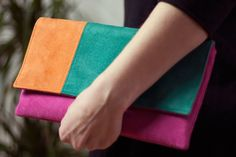 Small clutch made of three colored eco suede - emerald, pink, orange. Simple, practical design handbag bag can contain all you need - phone, wallet, lipstick.