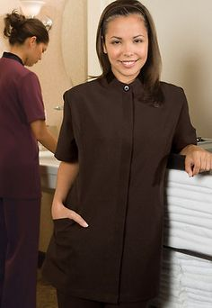 Women's Comfort Wicks Moisture Two Pockets Misses' Solid Tunic. 7278 Description  100% Polyester; 5.8 oz.wt. Tunic offers style and comfort, Short sleeve, hidden placket, two pockets, Contrasting collar on brown/merlot, Princess seams for shape, Scotchgard keeps stains at bay, Breathable fabric wicks moisture, Laundry friendly.  Care Instruction  Machine Wash Warm, Gentle Cycle, Only Non-Chlorine Bleach when Needed, Tumble Dry Low, Cool iron if needed.