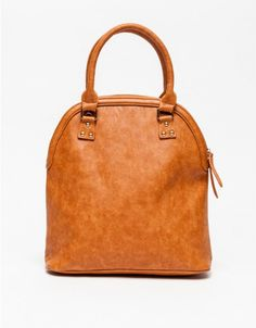 Soft, versatile handbag crafted from faux leather. Features a removable adjustable shoulder strap, carrying handles, gold-tone hardware, exterior zip pocket, interior zip pocket and side pockets.  	•	Faux leather handbag 	•	Removable adjustable shoulde