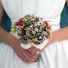 I am carrying one of these bad boys down the aisle. Made with grandmas brooches and other brooches found at antique malls