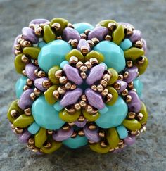REMINDER:  USE PURPLE SQUARES WITH THESE COLORS OF TURQ., OLIVINE, AND ROSE GOLD OR COPPER/BRONZE  .........................................................Beaded Bead by Vezsuzsi gyöngyei