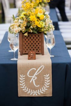 Monogram burlap table runner for the wedding reception. Perfect against a white tablecloth and sunflower centerpieces.