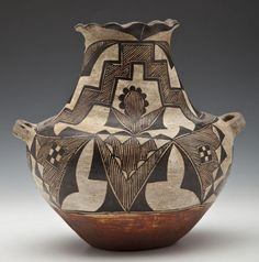 Globular body with long tapered neck with fluted rim and two strap handles. Decorated with hatched geometrics of black on white with red base. Native American Pottery, Native American Art, Antique Pottery, Pottery Art, New Mexico History, Southwest Pottery, Pueblo Pottery, Afro, Native Indian