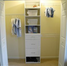 Nursery Closet Makeover.  Love the shelves and drawers in the middle of the racks