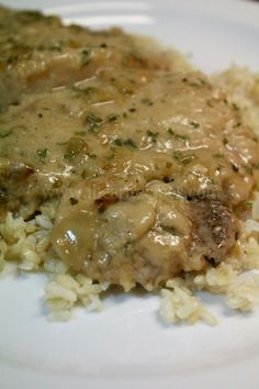 smothered pork chops--this is the one I made. Serving over mashed potatoes rather than rice...