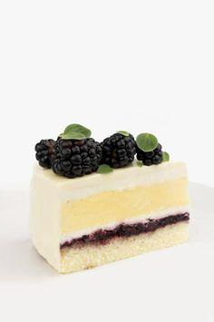 Blackberry honey and saffron entremet cake with blackberry coulis sponge cake honey mousse and saffron crème brûlée All glazed with white chocolate In. Fancy Desserts, Just Desserts, Delicious Desserts, Gourmet Desserts, Health Desserts, Plated Desserts, Entremet Cake, Entremet Recipe, Dacquoise