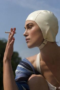 I want a retro swim cap like Keira Knightley's in Atonement (naturally it was made specifically for her head though. ugh.)