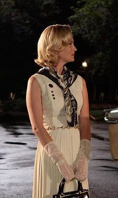 This is kind of when I saw Betty really transitioning into the wardrobe of a politician's wife. Suits her but ages her a little, doesn't it? Still really fresh and pretty. This pleated dress is one of my favorites.