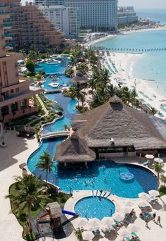 Mexican Caribbean Resort Hotel in the tropics with swimming pools, beach, and the ocean.