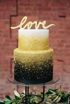 Modern Two-Tiered Wedding Cake with Black and Gold Details