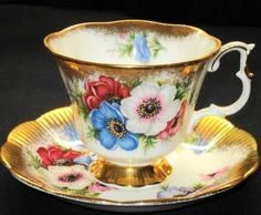 Royal albert england gold red wild anemone crest tea cup and saucer =