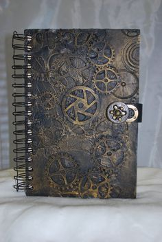For the Steampunk fan out there ;) Gold gear journal with latch by TheGoblinTrader on Etsy, $35.00