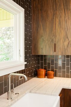 Design*Sponge | Kitchen Transformation//love this apron-front sink, and the vertical subway tile is dreamy!