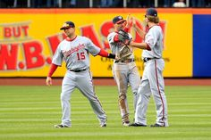 April 11th - WSH at NYM - Brett Carroll, Mark DeRosa, and Jayson Werth at the end of the Mets series. The Nationals take the win. Final Score: 4-0. Nationals are 4-2 this season, tied for first in the NL East.