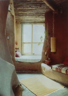 looks like straw bale or cob house with built in window seat/bed...lovely.