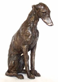 Sitting lurcher looking straight ahead, cast in bronze. This is number 2 of a limited edition of 12