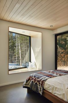 The cabins interiors have an airy palette of pale wooden ceilings, light concrete floors, and monochrome furniture.