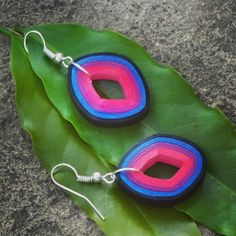 Multicolored Fashionable Earrings made from pink, purple, blue and black quilling strips. Can be customized based on your choice. Paper Cutting, Cut Paper, Quilling Earrings, Pink Purple, Blue, Fashion Earrings, Washer Necklace, Jewlery, Crochet Earrings