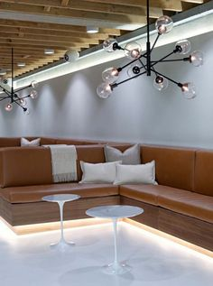 Camel color couches and white pillows at the Giant Pixel headquarters in San Francisco