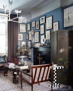 dark paint + picture wall + dark wood