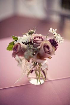 Roses and scabiosa. Purple, white and green.