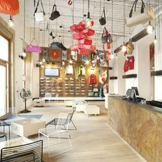 Puma store in Prague by EDIT! and Tereza Komárková where bags and clothing hang from steel ceiling chains. Fashion Retail Interior, Bar Interior, Interior Styling, Interior Paint, Interior Design Degree, Commercial Interior Design, Commercial Interiors, Dezeen Architecture, Interior Architecture