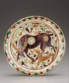 Plate | Origin:  Iran | Period: 10th-11th century | Details:  Not Available | Type: Glazed clay | Size: H: 8.2  W: 34.6  cm | Museum Code: F1927.2 | Photograph and description taken from Freer and the Sackler (Smithsonian) Museums.