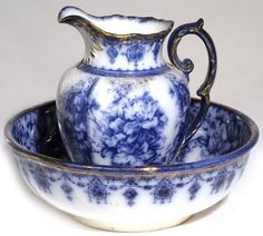 Antique Pitcher And Bowl Sets.  I'm not sure if this is the same pattern or not as the flow blue plates.