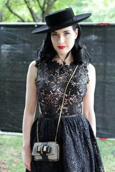 27 Street-Style Snaps From Lollapalooza  #refinery29  http://www.refinery29.com/lollapalooza-in-street-style-snaps#slide5  We have a serious girl crush on Dita Von Teese — and this bolero hat, sexy lace dress, and festival appropriate cross-body bag made us love her even more.