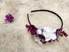 Flower headband in purple and white.