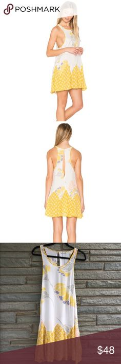Free People Someone Like You Trapeze Slip NWT. Free People Someone Like You Trapeze Slip in Ivory/Yellow. Features a Keyhole Opening in Back with Button Enclosure. 100% Rayon. Size L Free People Dresses
